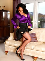Danica masturbating in silk blouse, black stockings and heels